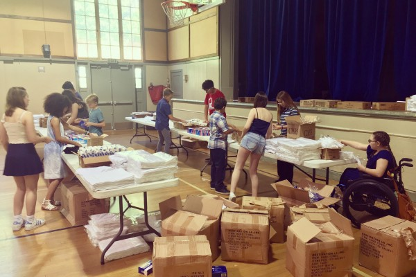 "09.24.17, Our Youth Group setting up the gym to make ""Health Kits"" for UMCOR"